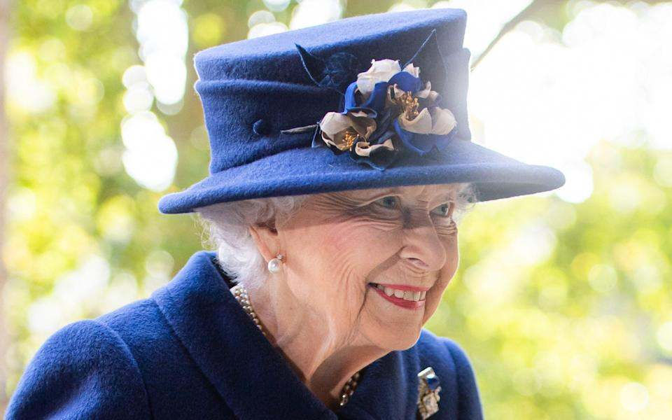 The Queen wore a deep blue dress and a matching hat with blue and white flowers - Samir Hussein/WireImage