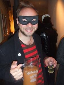 Dressed as bandit and offering drinks