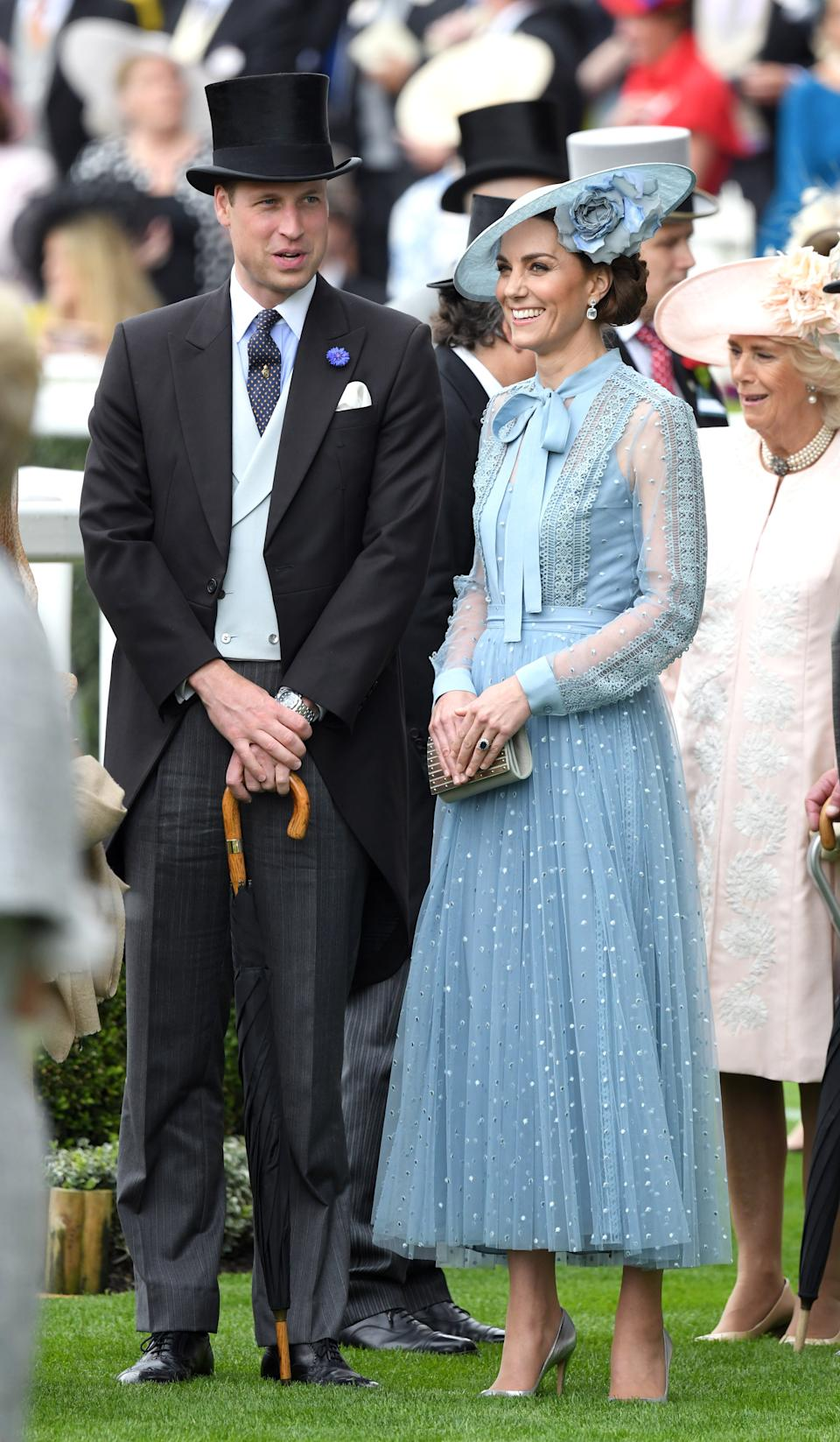 The couple co-ordinated beautifully for the occasion with Kate in a duck egg blue lace Elie Saab skirt and blouse combo and William in a duck egg blue waistcoat. <em>[Photo: Getty]</em>