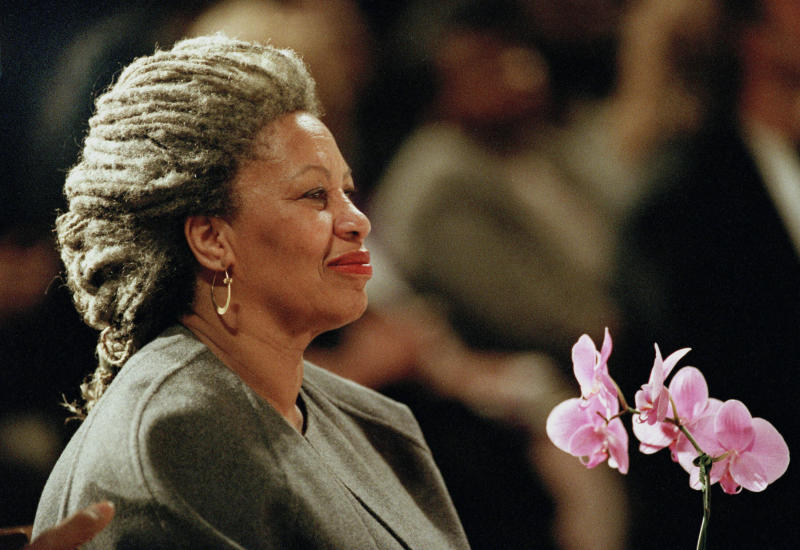 FILE - In this April 5, 1994 file photo, Toni Morrison as she holds an orchid at the Cathedral of St. John the Divine in New York.   The Nobel Prize-winning author has died. Publisher Alfred A. Knopf says Morrison died Monday, Aug. 5, 2019 at Montefiore Medical Center in New York. She was 88. (AP Photo/Kathy Willens, File)