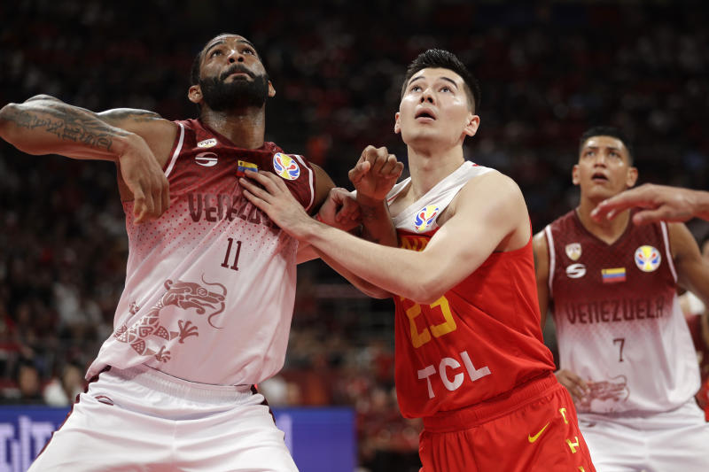 Luis Bethelmy of Venezuela and Abudushalamu Abudurexiti of China battle for a rebound during their group phase game in the FIBA Basketball World Cup at the Cadillac Arena in Beijing, Wednesday, Sept. 4, 2019. (AP Photo/Mark Schiefelbein)