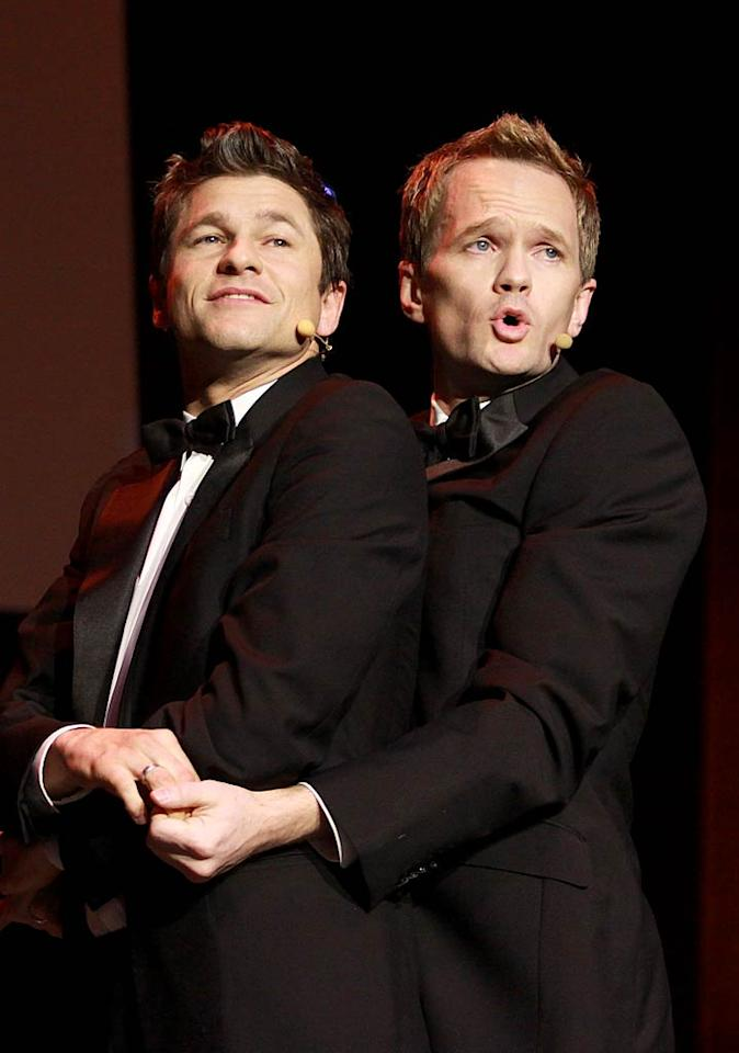 """Lucky for """"How I Met Your Mother"""" star Neil Patrick Harris (right), his fiance, David Burtka, is just as comfortable performing in front of a crowd as he is! (12/4/2011)"""
