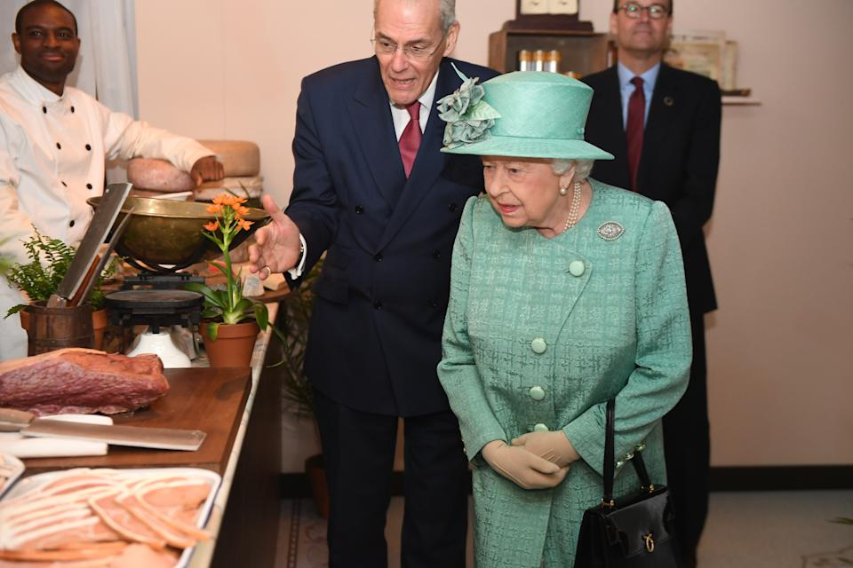 Queen Elizabeth II views goods on display in a replica of one of the original Sainsbury's stores during a visit to Covent Garden, London.