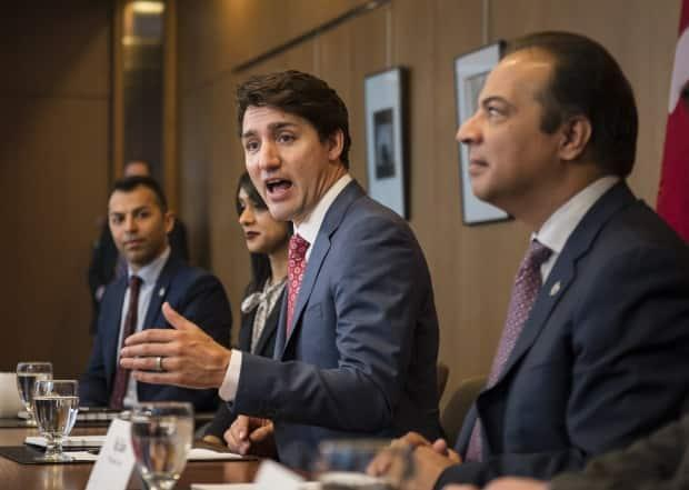 Liberal candidate in Kitchener Centre, Raj Saini, second from the right, alongside Liberal Leader Justin Trudeau, has been accused of behaving inappropriately toward young female staffers. He denies the allegations. (Christopher Katsarov/Canadian Press - image credit)