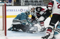 San Jose Sharks goaltender Alexei Melnichuk (1) guards against a shot by Arizona Coyotes center Lane Pederson (93) during the second period of an NHL hockey game in San Jose, Calif., Saturday, May 8, 2021. (AP Photo/John Hefti)