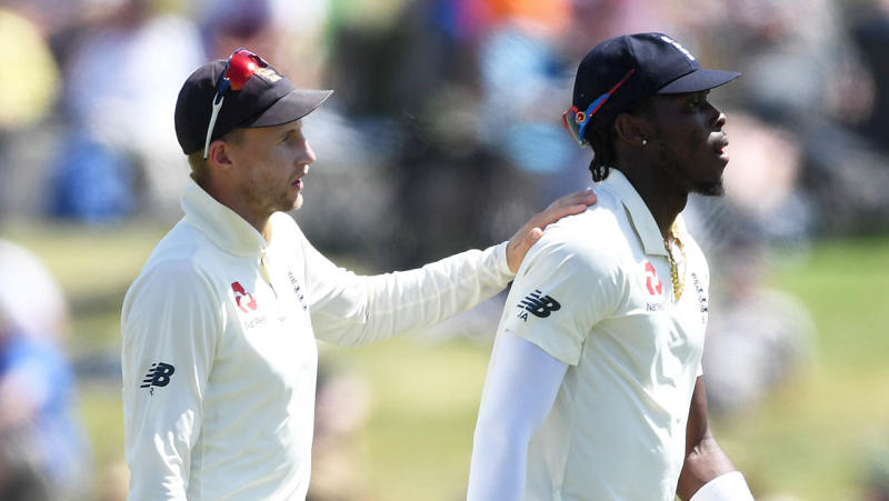England captain Joe Root speaks with Jofra Archer during day three of the first Test match between New Zealand and England. (Photo by Gareth Copley/Getty Images)