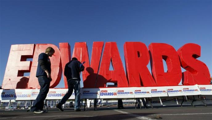John Edwards set up a giant sign outside the site of the Democratic debate in Las Vegas January 15, 2008.