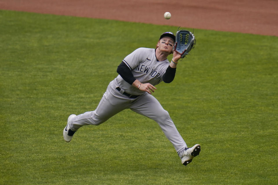 New York Yankees right fielder Clint Frazier makes a catch on a ball hit by Baltimore Orioles' Ryan Mountcastle to end the fourth inning of a baseball game, Sunday, May 16, 2021, in Baltimore. (AP Photo/Julio Cortez)