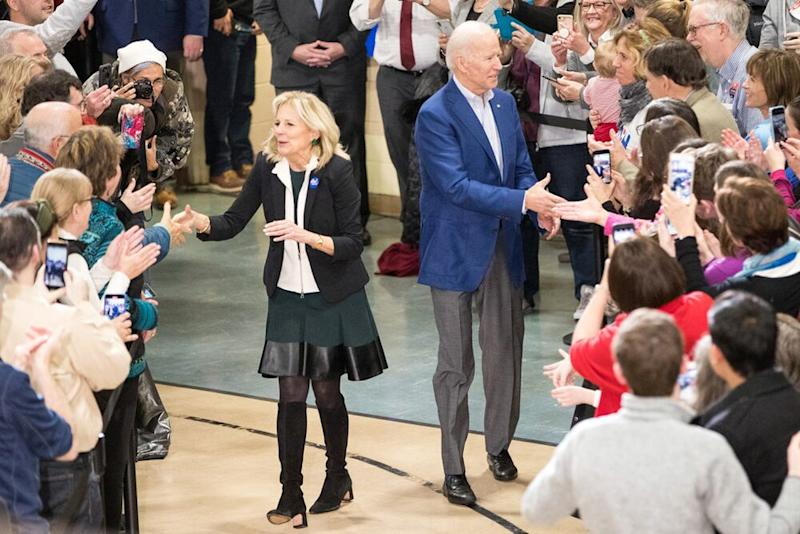 Jill Biden (left) shakes hands with voters alongside her husband, Joe Biden (right), at a New Hampshire event on Monday.   Scott Eisen/Getty