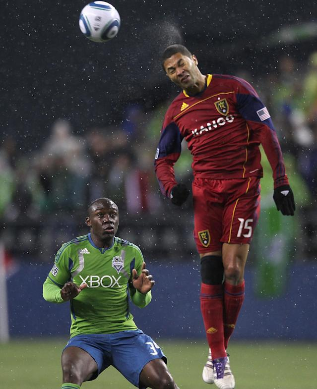SEATTLE - NOVEMBER 02: Alvaro Saborio #15 of Real Salt Lake heads the ball against Jhon Kennedy Hurtado #34 of the Seattle Sounders FC at CenturyLink Field on November 2, 2011 in Seattle, Washington. (Photo by Otto Greule Jr/Getty Images)