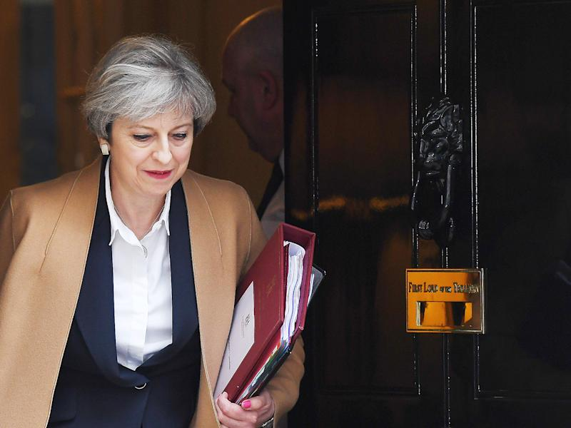 Theresa May's party is pushing her towards a hard Brexit including leaving the European single market: AP