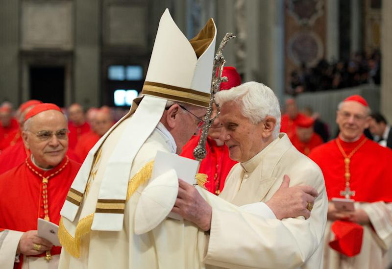 In this photo provided by the Vatican newspaper L'Osservatore Romano, Pope Francis, left, welcomes Pope Emeritus Benedict XVI during a consistory inside the St. Peter's Basilica at the Vatican, Saturday, Feb. 22, 2014. Retired Pope Benedict XVI joined Pope Francis at a ceremony Saturday creating the cardinals who will elect their successor in an unprecedented blending of papacies past, present and future. (AP Photo/L'Osservatore Romano, ho)