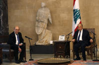 French Foreign Minister Jean-Yves Le Drian, left, meets with Lebanese President Michel Aoun at the Presidential Palace in Baabda, east of Beirut, Lebanon, Thursday, May 6, 2021. Le Drian is in Beirut for two days visit to meet with Lebanese officials. (AP Photo/Hussein Malla)