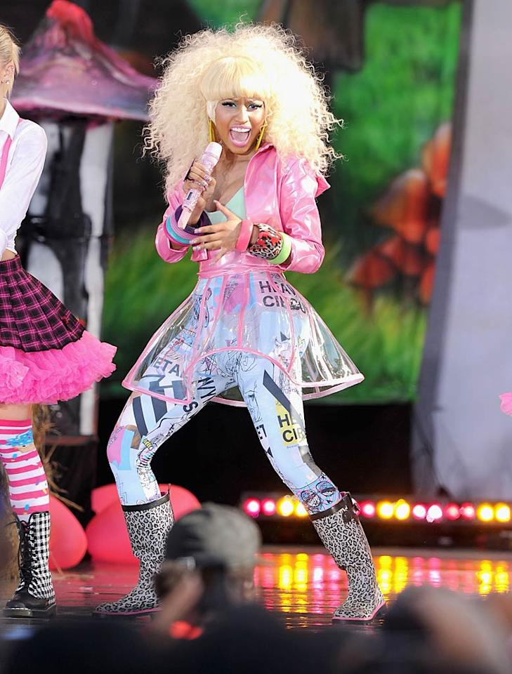 "Meanwhile, flamboyant rapper Nicki Minaj -- who is currently touring as Britney's opening act -- hit the stage for a performance on ABC's ""Good Morning America"" in this ghastly getup, which consisted of a bubblegum-pink vinyl bolero, see-thru skirt, loud leggings, and leopard print boots. Jamie McCarthy/<a href=""http://www.wireimage.com"" target=""new"">WireImage.com</a> - August 5, 2011"