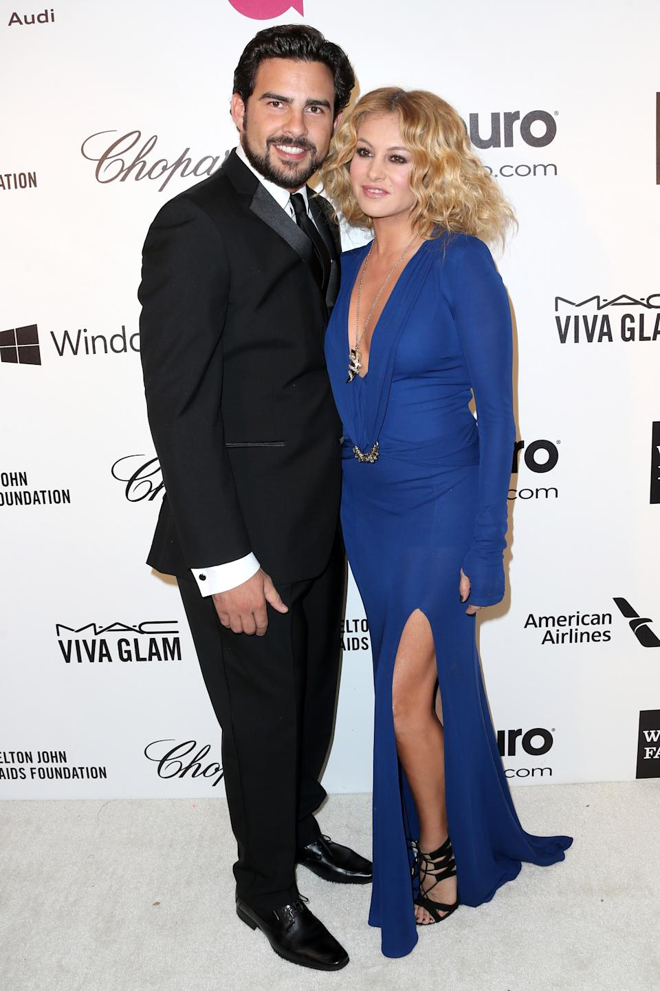 LOS ANGELES, CA - MARCH 02:  Singers Paulina Rubio (R) and Gerardo Bazua attend the 22nd Annual Elton John AIDS Foundation's Oscar Viewing Party on March 2, 2014 in Los Angeles, California.  (Photo by Frederick M. Brown/Getty Images)