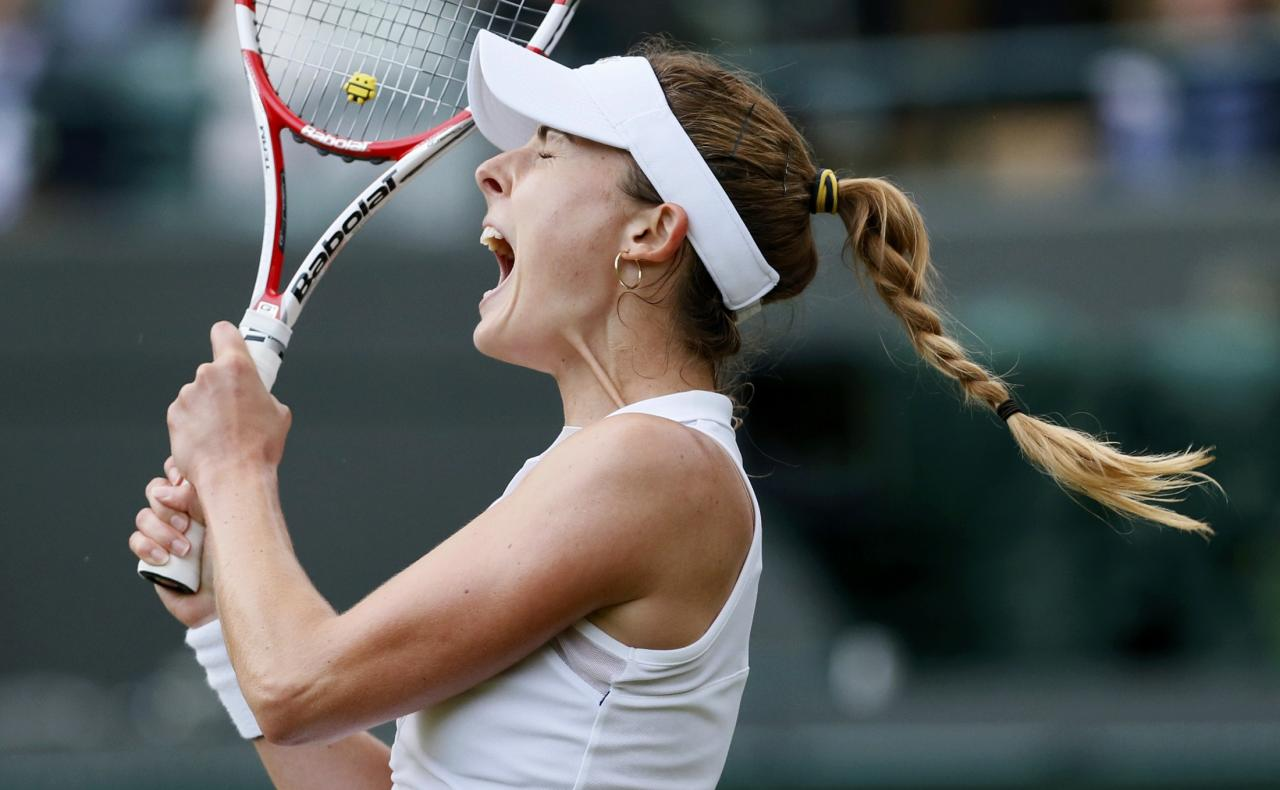 Alize Cornet of France reacts during her women's singles tennis match against Serena Williams of the U.S. at the Wimbledon Tennis Championships, in London June 28, 2014. REUTERS/Stefan Wermuth (BRITAIN - Tags: SPORT TENNIS TPX IMAGES OF THE DAY)