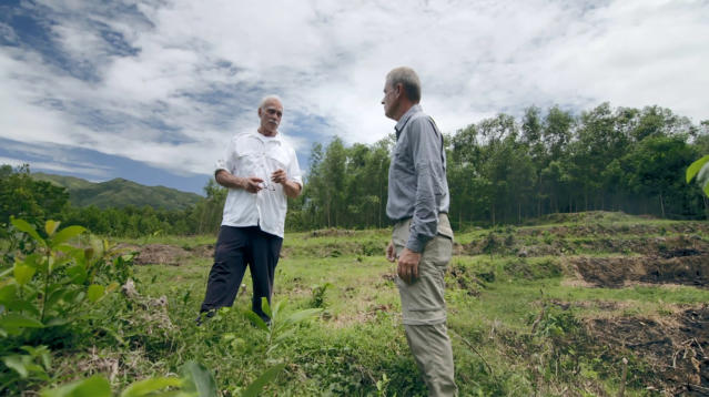 "In an image provided by ESPN from video, Rocky Bleier talks with ESPN reporter Tim Rinaldi in Hiep Duc Valley, about 35 miles (56 kilometers) south of Danang in Vietnam, on Aug. 20, 2018. Three months into his deployment to Vietnam, Bleier was shot through the thigh and suffered a grenade blast to his foot. Doctors told him that he'd never play football again. Steelers owner Art Rooney supported Bleier by placing him on injured reserve rather than cutting him from the team. Bleier then defied the odds, returning to football as a star running back on the ""Steel Curtain"" Steelers teams of the 1970s and becoming the only war veteran to have four Super Bowl rings. (ESPN via AP)"