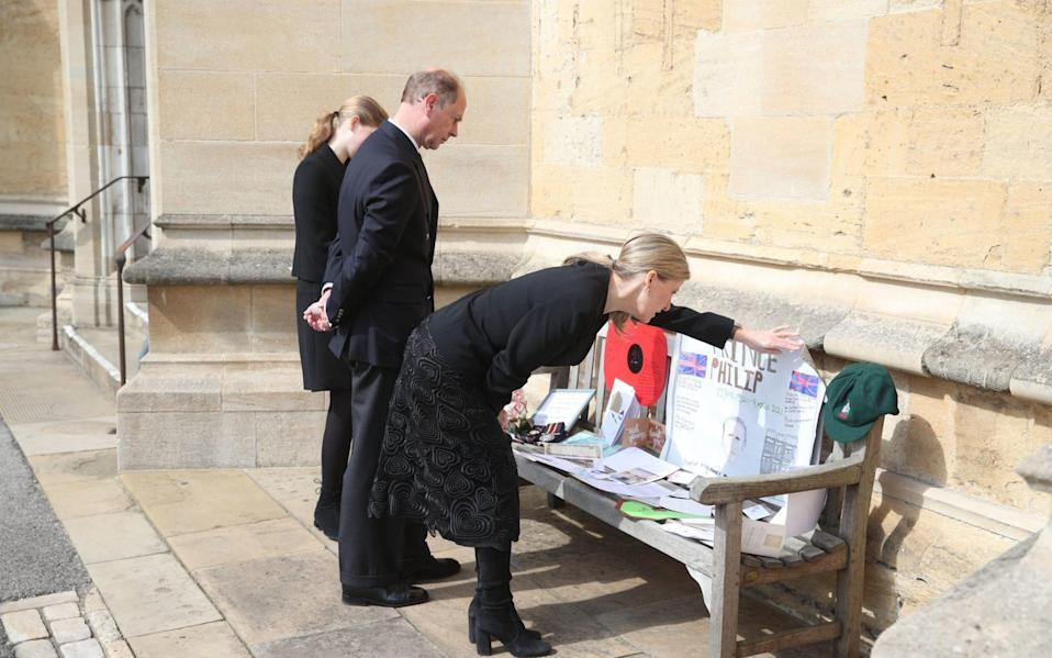 Lady Louise Windsor, Earl of Wessex and the Countess of Wessex view tributes outside St George's Chapel - Steve Parsons