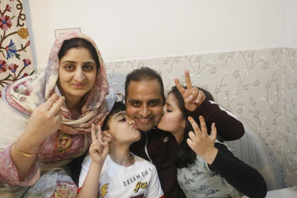 Associated Press photographer Mukhtar Khan celebrates with his family at his home in Srinagar, Indian controlled Kashmir, Tuesday, April 5, 2020, following the announcement that he was one of three AP photographers who won the Pulitzer Prize in Feature Photography for their coverage of the conflict in Kashmir and in Jammu, India. (AP Photo/Afnan Arif)