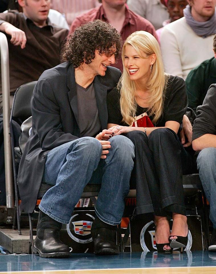 "Howard Stern shares an intimate moment with fiancee Beth Ostrosky at a New York Knicks game. Anthony J. Causi/<a href=""http://www.splashnewsonline.com"" target=""new"">Splash News</a> - December 9, 2007"