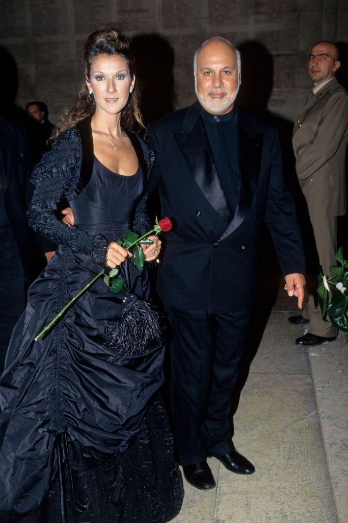 <p>Celine and her late husband, René Angéli, looked stunning at the Pavarotti and Friends event back in 1999. Her black ball gown was anything but boring with detailed ruching and a ruffled crop jacket.</p>