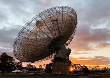 The radio telescope at the Parkes Observatory is pictured at sunset near the town of Parkes