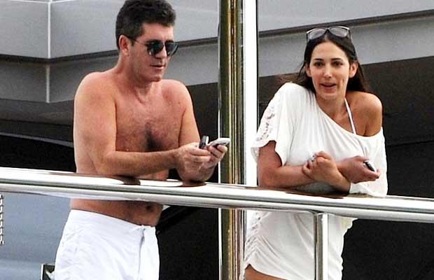 Simon Cowell enjoys the day with fiance Mezhgan Hussainy. PacificCoastNews.com