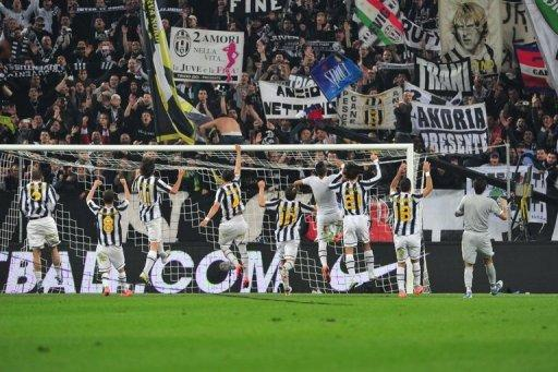 Juventus players celebrate after beating Inter Milan 2-0 on Sunday in Serie A to keep the heat on leaders AC Milan