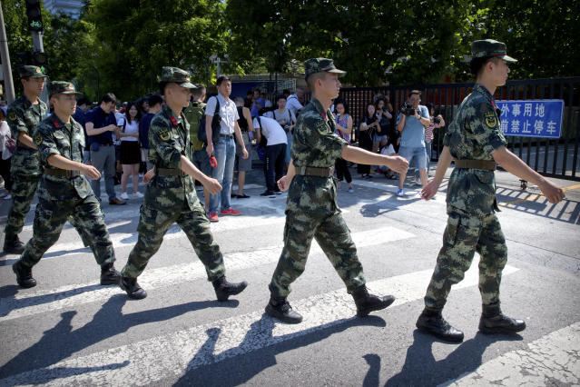 <p>Chinese paramilitary police march in formation past the site of an incident near the U.S. Embassy in Beijing, Thursday, July 26, 2018. (Photo: Mark Schiefelbein/AP) </p>