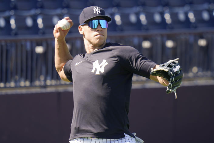 New York Yankees' Aaron Judge takes part in a drill during a spring training baseball workout Tuesday, Feb. 23, 2021, in Tampa, Fla. (AP Photo/Frank Franklin II)