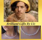 """<p><strong>BrilliantGiftsByLiz</strong></p><p>etsy.com</p><p><strong>$18.00</strong></p><p><a href=""""https://go.redirectingat.com?id=74968X1596630&url=https%3A%2F%2Fwww.etsy.com%2Flisting%2F879797560%2Fharry-styles-necklace-golden&sref=https%3A%2F%2Fwww.seventeen.com%2Ffashion%2Fg3085%2Fgifts-true-harry-styles-fan-needs-to-own%2F"""" rel=""""nofollow noopener"""" target=""""_blank"""" data-ylk=""""slk:Shop Now"""" class=""""link rapid-noclick-resp"""">Shop Now</a></p>"""