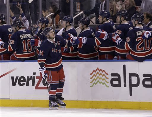 New York Rangers' Ryan Callahan celebrates his second goal with teammates during the third period of the NHL hockey game against the New Jersey Devils Sunday, April 21, 2013, in New York. The Rangers beat the Devils 4-1. (AP Photo/Seth Wenig)