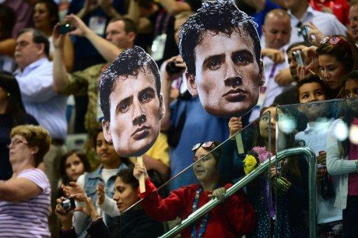 Fans hold giant placards of US swimmer Ryan Lochte during the medal ceremony for the men's 200m individual medley swimming event at the London 2012 Olympic Games in London. Lochte's London Olympics ended with a whimper on Thursday as a brutal backstroke-medley double failed to yield gold and he succumbed yet again to old foe Michael Phelps