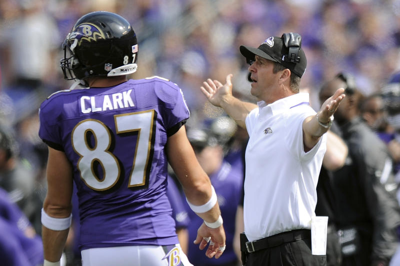 Baltimore Ravens head coach John Harbaugh, right, reacts to action on the field during the first half of an NFL football game against the Cleveland Browns in Baltimore, Md., Sunday, Sept. 15, 2013. (AP Photo/Nick Wass)