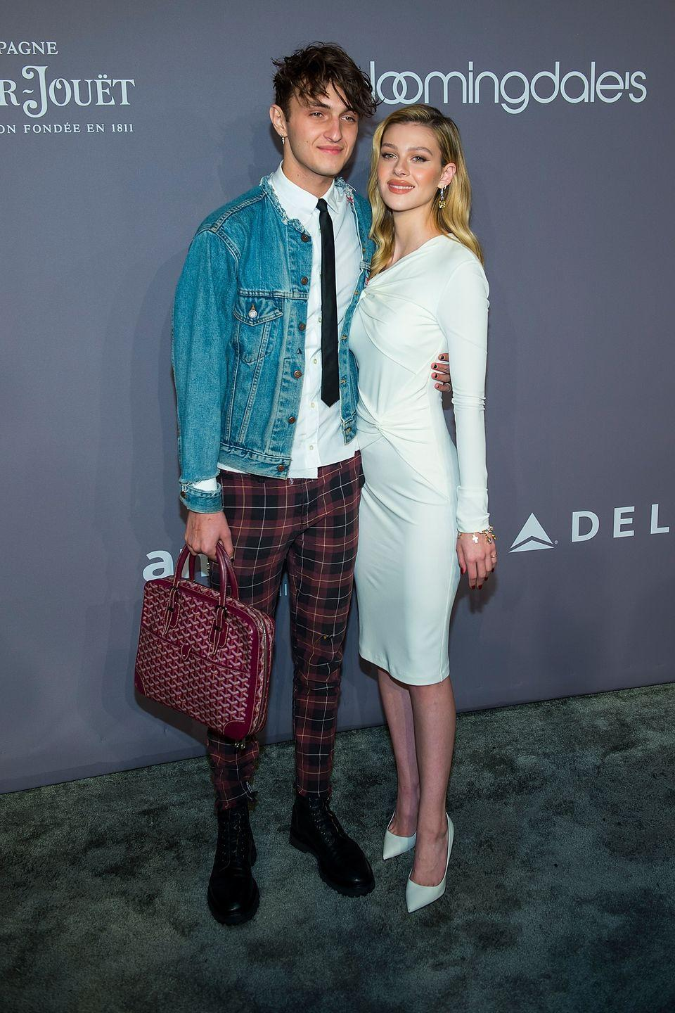 <p>The star walked the red carpet with her ex-boyfriend Anwar Hadid in a white one-shoulder midi, figure-hugging dress to the New York City event. She styled the look with heeled, pointed-toe shoes. </p>