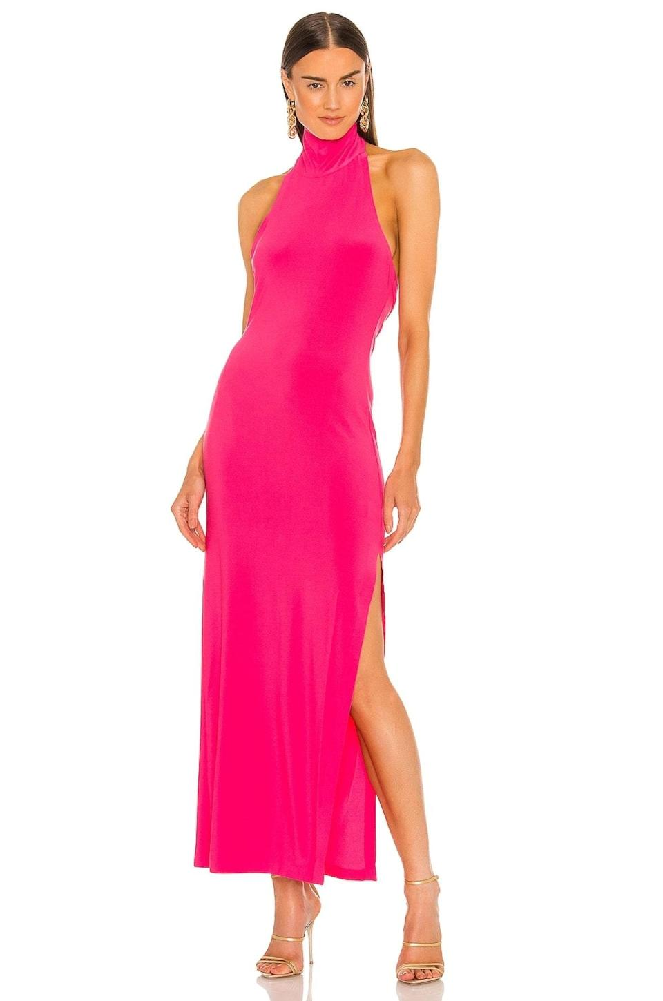 """Usher in turtleneck season with this floor-length dress that's ideal for an indoor reception or black-tie dress code. $145, Revolve. <a href=""""https://www.revolve.com/norma-kamali-halter-turtle-gown/dp/NKAM-WD286/"""" rel=""""nofollow noopener"""" target=""""_blank"""" data-ylk=""""slk:Get it now!"""" class=""""link rapid-noclick-resp"""">Get it now!</a>"""