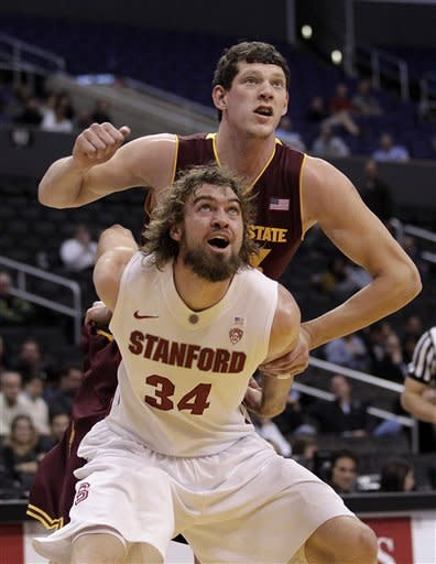 Stanford's Andrew Zimmermann (34) and Arizona State's Ruslan Pateev fight for position during the first half of an NCAA college basketball game at the Pac-12 Conference tournament in Los Angeles, Wednesday, March 7, 2012. (AP Photo/Jae C. Hong)