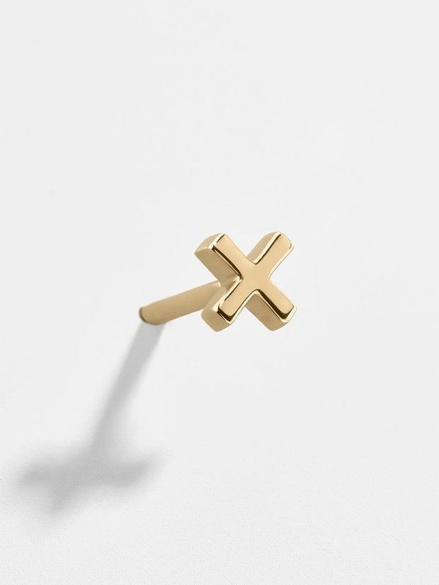 """<h3>BaubleBar """"X"""" 14K Gold Single Earring<br></h3> <br>A simple, solid gold """"x"""" makes a decisive statement when added to a lineup of multiple piercings.<br><br><em>Shop fine jewelry at <strong><a href=""""http://baublebar.com"""" rel=""""nofollow noopener"""" target=""""_blank"""" data-ylk=""""slk:BaubleBar"""" class=""""link rapid-noclick-resp"""">BaubleBar</a></strong></em><br><br><strong>BaubleBar</strong> X 14K Solid Gold Single Stud Earring, $, available at <a href=""""https://go.skimresources.com/?id=30283X879131&url=https%3A%2F%2Fwww.baublebar.com%2Fproduct%2F51049-x-14k-solid-gold-single-stud-earring"""" rel=""""nofollow noopener"""" target=""""_blank"""" data-ylk=""""slk:BaubleBar"""" class=""""link rapid-noclick-resp"""">BaubleBar</a><br><br><br>"""