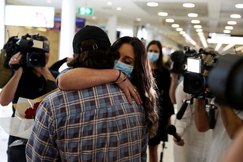 Passengers arrive from New Zealand after the Trans-Tasman travel bubble opened overnight, at Sydney Airport