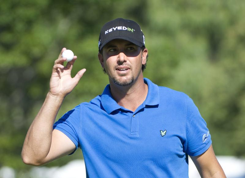 CORRECTS BYLINE TO NATHAN DENETTE NOT DAVE CHIDLEY - Scott Piercy reacts to the crowed on 18 during the Canadian Open golf tournament at the Hamilton Golf and County Club in Ancaster, Ontario, Sunday, July 29, 2012. Piercy won. (AP Photo/The Canadian Press, Nathan Denette)