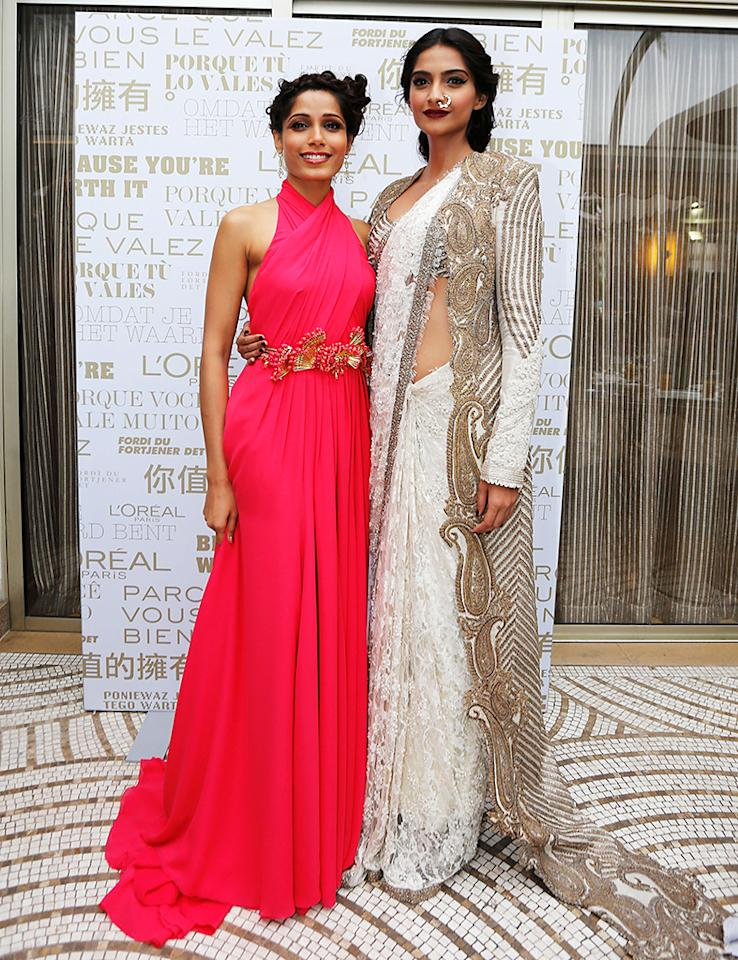 CANNES, FRANCE - MAY 15:  (L-R) Freida Pinto and Sonam Kapoor attend a  L'Oreal Cocktail Reception during The 66th Annual Cannes Film Festival at the Martinez Hotel on May 15, 2013 in Cannes, France.  (Photo by Traverso/L'Oreal/Getty Images)