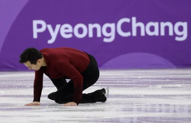Patrick Chan of Canada falls in the men's single skating free skating in the Gangneung Ice Arena at the 2018 Winter Olympics in Gangneung, South Korea, Monday, Feb. 12, 2018. (AP Photo/David J. Phillip)