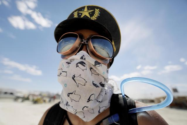 <p>Burning Man participant Marie Sbrocca of San Francisco explores Black Rock City on her bicycle as approximately 70,000 people from all over the world gathered for the 1st full day of the annual Burning Man arts and music festival in the Black Rock Desert of Nevada, Aug. 28, 2017. (Photo: Jim Bourg/Reuters) </p>