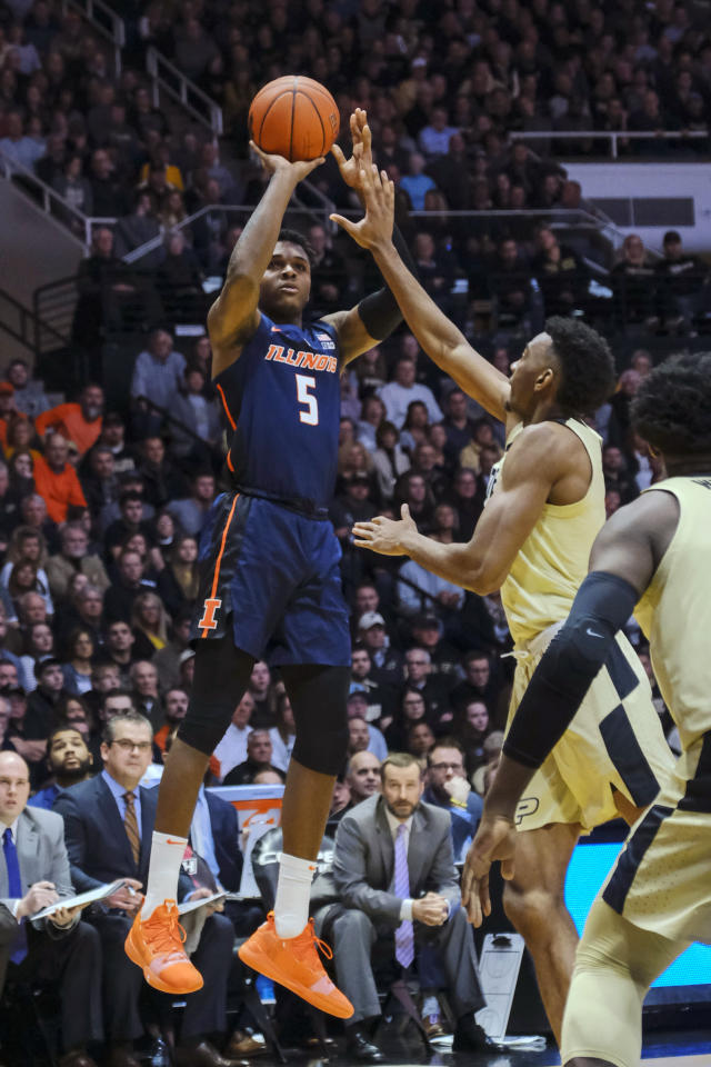 Illinois guard Tevian Jones (5) shoots over Purdue forward Aaron Wheeler during the first half of an NCAA college basketball game in West Lafayette, Ind., Wednesday, Feb. 27, 2019. (AP Photo/AJ Mast)