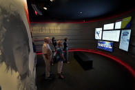 People view an exhibit about the Korean War during a tour of the Harry S. Truman Presidential Library and Museum Wednesday, June 9, 2021, in Independence, Mo. The facility will reopen July 2 after a nearly $30 million renovation project. (AP Photo/Charlie Riedel)