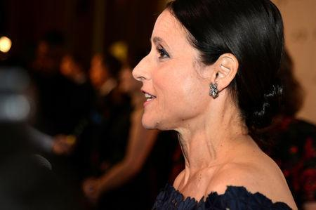 FILE PHOTO: Comedian and actor Julia Louis-Dreyfus poses for photographers on the red carpet as she arrives to be awarded the Kennedy Center's 21st annual Mark Twain Prize for American Humor, in Washington, U.S., October 21, 2018. REUTERS/Mike Theiler