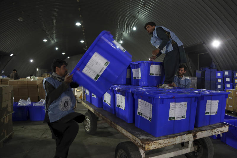 Election commission workers move ballot boxes in preparation for the presidential election scheduled for Sept 28, at the Independent Election Commission compound in Kabul, Afghanistan, Sunday, Sept. 15, 2019. Afghan officials say around 100,000 members of the country's security forces are ready for polling day. (AP Photo/Rahmat Gul)