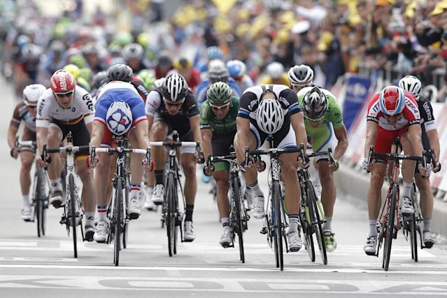 Marcel Kittel of Germany, center right, crosses the finish line ahead of second place Norway's Alexander Kristoff, far right, and third place France's Arnaud Demare, second left, to win the fourth stage of the Tour de France cycling race over 163.5 kilometers (101.6 miles) with start in Le Touquet and finish in Lille, France, Tuesday, July 8, 2014. Far left is Germany's Andre Greipel. (AP Photo/Peter Dejong)