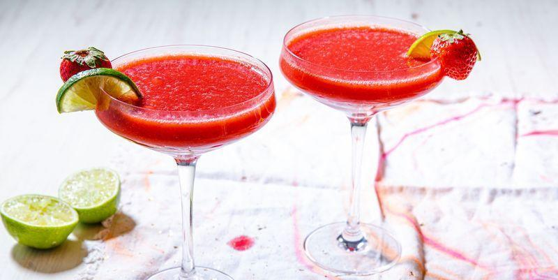 """<p>This fruity frozen favourite is a surefire crowd-pleaser, especially in the summertime. </p><p>Get the <a href=""""https://www.delish.com/uk/cocktails-drinks/a29571550/strawberry-daiquiri-frozen-drinks/"""" rel=""""nofollow noopener"""" target=""""_blank"""" data-ylk=""""slk:Strawberry Daiquiri"""" class=""""link rapid-noclick-resp"""">Strawberry Daiquiri</a> recipe. </p>"""