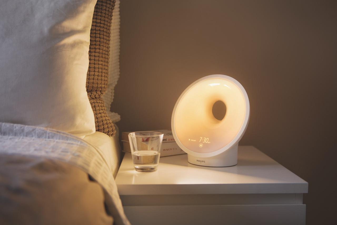 "Introducing healthy patterns goes a long way in helping us fall and stay asleep. With Philips's most advanced lamp, built-in sensors measure your bedroom's temperature, noise, light, and humidity levels. With that information, the lamp syncs the data with a smartphone app while suggesting ways to improve your space. The time appears in a purposely small point size, so that if you do happen to find yourself sleepless, the time of night will not be brightly shining in your face. Furthermore, the device can mimic a sunrise (ranging in intensity from bright white sunrise to a crisp Nordic morning) as well as the noises of nature at dawn. <a href=""https://www.usa.philips.com/c-p/HF3670_60/smartsleep-connected-sleep-and-wake-up-light""><em>philips.com</em></a>"